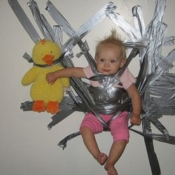 baby taped to wall